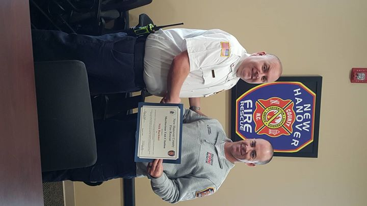 Captain Buckner receiving his Meritorious Unit Award for his actions during Hurricane Florence.
