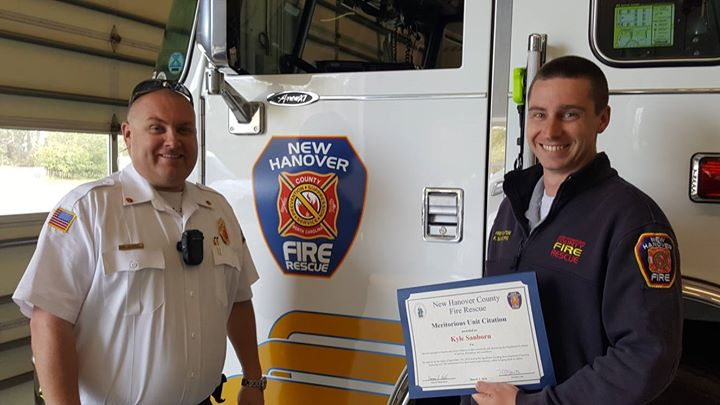 Firefighter Sanborn receiving his Meritorious Unit Award for his efforts during Hurricane Florence.